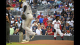 Atlanta Braves' Ronald Acuna Jr. stands at first base after being hit by a pitch thrown by Miami Marlins' Elieser Hernandez during the first inning of a baseball game Tuesday, Aug. 20, 2019, in Atlanta. (AP Photo/John Amis)
