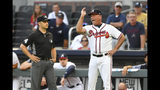 Atlanta Braves manager Brian Snitker argues with umpire Mark Wegner, left, after being ejected from a baseball game against the Miami Marlins in the first inning, Tuesday, Aug. 20, 2019, in Atlanta. Ronald Acuna Jr. had been hit with a pitch during the previous play. (AP Photo/John Amis)