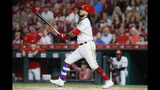 Cincinnati Reds' Freddy Galvis watches his two-run home run off San Diego Padres starting pitcher Cal Quantrill during the sixth inning of a baseball game Tuesday, Aug. 20, 2019, in Cincinnati. (AP Photo/John Minchillo)