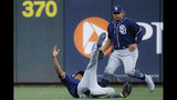 San Diego Padres center fielder Manuel Margot, center, catches the ball for the out on Cincinnati Reds' Jose Iglesias during the second inning of a baseball game Tuesday, Aug. 20, 2019, in Cincinnati. (AP Photo/John Minchillo)
