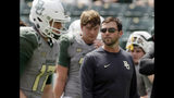 FILE - In this Sept. 10, 2016, file photo, Baylor offensive coordinator Kendal Briles, right, watches players warm up before an NCAA college football game against SMU in Waco, Texas. Coach Willie Taggart drew some scrutiny for hiring Briles, who worked for his father, Art, at Baylor as that school went through a bruising scandal tied to sexual assault accusations. He will have to work around a deficient offensive line, but if the offense clicks then Taggart's second year in Tallahassee should be much better than his first. (AP Photo/LM Otero, File)