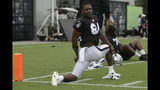 Oakland Raiders' Antonio Brown stretches during NFL football practice in Alameda, Calif., Tuesday, Aug. 20, 2019. (AP Photo/Jeff Chiu)