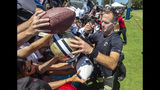 New Orleans Saints quarterback Drew Brees signs autographs for fans following a joint NFL football practice with the Los Angeles Chargers in Costa Mesa, Calif., Thursday, Aug. 15, 2019. (Mark Rightmire/The Orange County Register via AP)