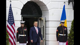 President Donald Trump arrives to greet Romanian President Klaus Iohannis upon his arrival on the South Lawn of the White House, Tuesday, Aug. 20, 2019, in Washington. (AP Photo/Alex Brandon)