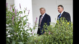 President Donald Trump, left, walks with Romanian President Klaus Iohannis, right, along the Colonnade of the White House in Washington, Tuesday, Aug. 20, 2019. (AP Photo/Susan Walsh)
