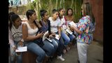 In this photo taken July 25, 2019, women listen to a nurse before getting hormonal implants to prevent pregnancies at a clinic in the impoverished Caucaguita neighborhood on the outskirts of Caracas, Venezuela. The U.N. Population Fund has imported 45,000 hormonal implants so far with the government's authorization. (AP Photo/Ariana Cubillos)