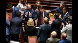 Italian Premier Giuseppe Conte, center, is congratulated at the end of his address to the Senate, in Rome, Tuesday, Aug. 20, 2019. Italian Premier Giuseppe Conte has told senators he's handing in his resignation because his right-wing coalition partner has yanked its support for the populist government. (Ettore Ferrari/ANSA via AP)