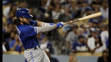 Toronto Blue Jays' Bo Bichette hits a solo home run against the Los Angeles Dodgers during the sixth inning of a baseball game Tuesday, Aug. 20, 2019, in Los Angeles. (AP Photo/Marcio Jose Sanchez)