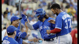 Toronto Blue Jays' Bo Bichette, center, celebrates his solo home run with teammates and coaches during the first inning of a baseball game against the Los Angeles Dodgers on Tuesday, Aug. 20, 2019, in Los Angeles. (AP Photo/Marcio Jose Sanchez)