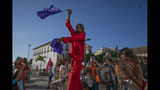 Activists march against the Brazilian government's environmental policies, on the sidelines of the Latin America and Caribbean Climate Week (LACCW) 2019, a meeting on climate change, in Salvador, Brazil, Wednesday, Aug. 21, 2019. Environment Minister Salles was booed Wednesday as he took the stage at the five-day U.N. workshop in Salvador, an event he had tried to cancel earlier this year. (AP Photo/Victor R. Caivano)