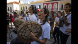 Protesters sing and play drums during a march against the Brazilian government's environmental policies, on the sidelines of a climate change meeting in Salvador, Brazil, Wednesday, Aug. 21, 2019. Environment Minister Salles was booed Wednesday as he took the stage at a five-day U.N. workshop on climate change in Salvador, an event he had tried to cancel earlier this year. (AP Photo/Victor R. Caivano)