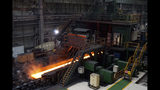 In this July 24, 2019, photo, red-hot steel rolls along a conveyor inside a mill of Ansteel's Bayuquan Production Base in Yingkou in northeastern China's Liaoning Province. Authorities in China's rust-belt region are looking for support for its revival from Beijing's multibillion-dollar initiative to build ports, railways and other projects abroad. (AP Photo/Olivia Zhang)
