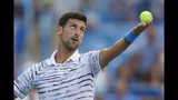 Novak Djokovic, of Serbia, tosses the ball on a serve to Daniil Medvedev, of Russia, during the Western & Southern Open tennis tournament Saturday, Aug. 17, 2019, in Mason, Ohio. (AP Photo/John Minchillo)