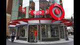FILE - In this July 10, 2019, file photo shoppers visit the downtown Target Store in Minneapolis. Target Corp. reports financial results Wednesday, Aug. 21. (AP Photo/Jim Mone, File)