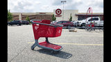 FILE - In this June 3, 2019, file photo a shopping cart sits in the parking lot of a Target store in Marlborough, Mass. Target Corp. reports financial results Wednesday, Aug. 21. (AP Photo/Bill Sikes, File)