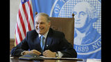 FILE - In this Feb. 27, 2019 file photo, Washington Gov. Jay Inslee sits in front of the state seal as he takes part in a conference call meeting at the Capitol in Olympia, Wash. Inslee, who made fighting climate change the central theme of his presidential campaign, announced Wednesday night, Aug. 21, 2019, that he is ending his bid for the 2020 Democratic nomination. (AP Photo/Ted S. Warren, File)