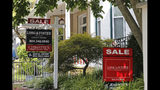 In this Friday, Aug. 16, 2019, photo for sale signs beckon buyers to homes along Park Avenue in Richmond, Va. On Wednesday, Aug. 21, the National Association of Realtors reports on sales of existing homes in July. (AP Photo/Steve Helber)
