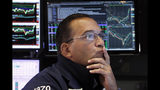 FILE - In this Aug. 16, 2019, file photo specialist Anthony Matesic works on the floor of the New York Stock Exchange. The U.S. stock market opens at 9:30 a.m. EDT on Wednesday, Aug. 21. (AP Photo/Richard Drew, File)