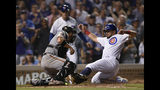 Chicago Cubs' Kyle Schwarber right, is tagged out at home plate by San Francisco Giants catcher Stephen Vogt during the eighth inning of a baseball game Wednesday, Aug 21, 2019, in Chicago. Chicago won 12-11. (AP Photo/Paul Beaty)