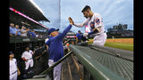 Chicago Cubs' Nicholas Castellanos right, celebrates with manager Joe Maddon at the dugout after hitting a two-run home run during the first inning of the team's baseball game against the San Francisco Giants on Wednesday, Aug 21, 2019, in Chicago. (AP Photo/Paul Beaty)