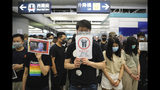 "Demonstrators stand in silence during a protest at the Yuen Long MTR station in Hong Kong, Wednesday, Aug. 21, 2019. Japan's top diplomat on Tuesday told his Chinese counterpart that Japan is ""deeply concerned"" about the continuing protests in Hong Kong. (AP Photo/Kin Cheung)"