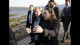 Iceland's Prime Minister Katrin Jakobsdottir, right, meets with German Chancellor Angela Merkel at Thingvellir National Park, about 40km from Reykjavik in Iceland, Monday Aug. 19, 2019. Merkel met with Jakobsdottir on Monday ahead of a meeting with Nordic leaders in Reykjavik on Tuesday. (AP Photo/Egill Bjarnason)