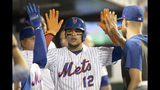 New York Mets' Juan Lagares celebrates after scoring on a double by Luis Guillorme during the fifth inning of the team's baseball game against the Cleveland Indians, Wednesday, Aug. 21, 2019, in New York. (AP Photo/Mary Altaffer)
