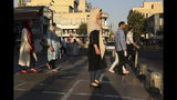 Pedestrians walk on a sidewalk in eastern Tehran, Iran, Monday, Aug. 19, 2019. (AP Photo/Vahid Salemi)