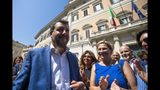 Italian Deputy-Premier and Interior Minister, Matteo Salvini walks outside the lower chamber in Rome, Wednesday, Aug. 21, 2019. Italy could see elections as early as this fall after Italian Premier Giuseppe Conte resigned amid the collapse of the 14-month-old populist government. Matteo Salvini's right-wing League party sought a no-confidence vote against Conte earlier this month, a stunningly bold move for the government's junior coalition partner. (Angelo Carconi/ANSA via AP)