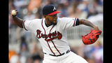 Atlanta Braves' Julio Teheran pitches against the Miami Marlins during the first inning of a baseball game Wednesday, Aug. 21, 2019, in Atlanta. (AP Photo/John Amis)