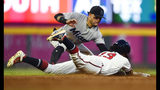 Atlanta Braves' Ronald Acuna Jr. is caught stealing second base by Miami Marlins second baseman Isan Diaz, left, during the third inning of a baseball game Wednesday, Aug. 21, 2019, in Atlanta. (AP Photo/John Amis)