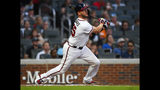 Atlanta Braves' Tyler Flowers hits an RBI triple to center field during the second inning of a baseball game against the Miami Marlins, Wednesday, Aug. 21, 2019, in Atlanta. (AP Photo/John Amis)