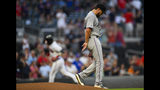 Miami Marlins pitcher Caleb Smith walks away from the mound as Atlanta Braves' Adeiny Hechavarria runs bases during his two-run home run over center field in the second inning of a baseball game Wednesday, Aug. 21, 2019, in Atlanta. (AP Photo/John Amis)