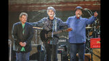 FILE - This April 6, 2017 file photo shows Jeff Cook, from left, Randy Owen and Teddy Gentry, from the southern rock band Alabama, performing at the Bridgestone Arena in Nashville, Tenn. The band says it is postponing the remainder of its 50th anniversary tour as lead singer Owen battles health complications. The band announced Wednesday, Aug. 21, that the 69-year-old singer is suffering from migraines and vertigo, and doctors say he needs more time to recover. (Photo by Al Wagner/Invision/AP, File)