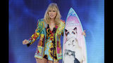 FILE - In this Aug. 11, 2019 file photo, Taylor Swift accepts the Icon award at the Teen Choice Awards in Hermosa Beach, Calif. Swift plans to re-record her songs after her catalog was purchased by popular music manager Scooter Braun. (Photo by Danny Moloshok/Invision/AP, File)