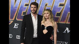 """FILE - In this Monday, April 22, 2019, file photo, Liam Hemsworth, left, and Miley Cyrus arrive at the premiere of """"Avengers: Endgame"""" at the Los Angeles Convention Center. Liam Hemsworth is seeking a divorce from Miley Cyrus after seven months of marriage. The 29-year-old Australian actor filed for the dissolution of his marriage to the 26-year-old American pop star in Los Angeles Superior Court on Wednesday, Aug. 21, 2019. (Photo by Jordan Strauss/Invision/AP, File)"""