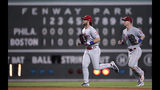 Philadelphia Phillies right fielder Bryce Harper, left, and left fielder Corey Dickerson head to the clubhouse after the team's win over the Boston Red Sox in a baseball game at Fenway Park in Boston, Wednesday, Aug. 21, 2019. The Phillies won 5-2. (AP Photo/Charles Krupa)