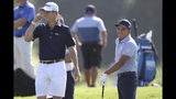 Justin Thomas, left, shares a laugh with Rickie Fowler as they prepare to play a practice round for the Tour Championship golf tournament in Atlanta, Wednesday, Aug. 21, 2019. (Curtis Compton/Atlanta Journal-Constitution via AP)