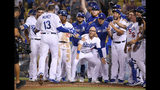 Los Angeles Dodgers wait for Max Muncy to score on a game-ending solo home run during the 10th inning of the team's baseball game against the Toronto Blue Jays on Wednesday, Aug. 21, 2019, in Los Angeles. The Dodgers won 2-1. (AP Photo/Mark J. Terrill)