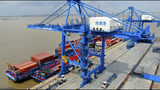 """FILE - In this July 18, 2019, file photo, shipping containers are loaded onto a cargo ship at a port in Nantong in eastern China's Jiangsu province. Beijing appealed to Washington on Wednesday, Aug. 21, to """"meet China halfway"""" and end a tariff war after President Donald Trump said Americans might need to endure economic pain to achieve longer-term benefits. (Chinatopix via AP)"""