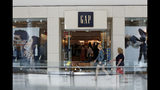 FILE - This Aug. 31, 2017, file photo shows a sign for a Gap store in Pittsburgh. The Gap Inc. reports financial results Thursday, Aug. 22. (AP Photo/Gene J. Puskar, File)