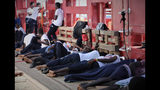 In this Aug. 13, 2019 photo made available Monday, Aug. 19, 2019, rescued migrants rest on the deck of the Norwegian-flagged Ocean Viking vessel, operated by two French humanitarian groups, as it sails in the waters between the Italian island of Linosa, southern Italy, and Malta. Another potential migrant standoff looms as the Ocean Viking, carrying 356 migrants, has been sailing for 10 days without being able to dock after Malta refused to find a safe port while Italy hasn't answered the ship's request. (Hannah Wallace Bowman/MSF via AP)
