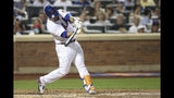 New York Mets' Wilson Ramos hits a two-run double during the fourth inning of the team's baseball game against the Cleveland Indians, Thursday, Aug. 22, 2019, in New York. (AP Photo/Mary Altaffer)