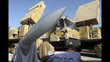 In this photo released by the official website of the office of the Iranian Presidency, Iran-made Bavar-373 air-defense missile system is seen after being unveiled by President Hassan Rouhani, Iran, Thursday, Aug. 22, 2019. Iran says the Bavar-373 is a long-range surface-to-air missile system able to recognize up to 100 targets at a same time and confront them with six different weapons. (Iranian Presidency Office via AP)