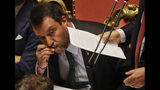 FILE - In this Aug. 20, 2019, file photo, Italian Deputy-Premier Matteo Salvini kisses a rosary as Premier Giuseppe Conte addresses the Senate in Rome. For months now, Salvini, a divorced father of two children by two different women, has been kissing rosaries, invoking the Madonna and quoting St. John Paul II at political rallies in a bid to rally Italian Catholics behind his nationalist message. (AP Photo/Gregorio Borgia, File)