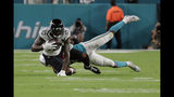 Miami Dolphins cornerback Eric Rowe, bottom, tackles Jacksonville Jaguars wide receiver Terrelle Pryor (10) during the first half of an NFL football preseason game, Thursday, Aug. 22, 2019 in Miami Gardens, Fla. (AP Photo/Lynne Sladky)