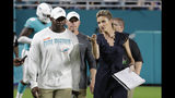 Fox NFL sportscaster Erin Andrews, right, talks with Miami Dolphins head coach Brian Flores, left, before the second half of an NFL football preseason game against the Jacksonville Jaguars, Thursday, Aug. 22, 2019 in Miami Gardens, Fla. (AP Photo/Lynne Sladky)
