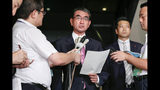 "Japanese Foreign Minister Taro Kono, center, speaks to reporters following South Korea's announcement that it will terminate an intelligence-sharing deal with Japan, at Foreign Ministry in Tokyo Thursday, Aug. 22, 2019. South Korea terminated an intelligence-sharing deal with Japan amid a bitter trade dispute, a surprise decision that is likely to set back U.S. efforts to bolster security cooperation with two of its most important allies in Asia. Kono called the decision ""extremely regrettable"" and summoned the South Korean ambassador to protest the linking of trade and security issues. (Naoya Osato/Kyodo News via AP)"