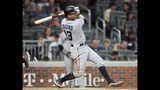 Miami Marlins' Starlin Castro doubles in two runs against the Atlanta Braves in the seventh inning of a baseball game Thursday, Aug. 22, 2019, in Atlanta. (AP Photo/Tami Chappell)
