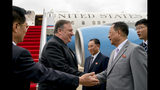 """FILE - In this July 6, 2018, file photo, U.S. Secretary of State Mike Pompeo, second from left, is greeted by North Korean Director of the United Front Department Kim Yong Chol, center, and North Korean Foreign Minister Ri Yong Ho, second from right, as he arrives at Sunan International Airport in Pyongyang, North Korea. Ri called Pompeo a """"poisonous plant of American diplomacy"""" who hampers efforts to restart nuclear negotiations. Ri issued crude insults against Pompeo on Friday, Aug. 23, 2019 to protest what he called Pompeo's recently reported comments that Washington will maintain crippling sanctions on North Korea unless it denuclearizes. (AP Photo/Andrew Harnik, Pool, File)"""